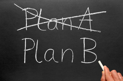 Crossing out Plan A and writing Plan B on a blackboard.